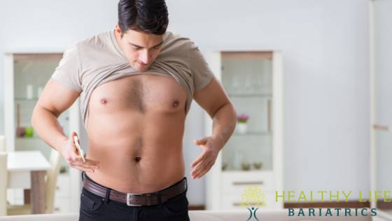 Man Checking Weight after Weight Loss